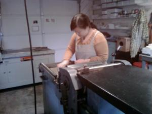 Lynn working on her Vandercook press