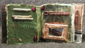 Page 3 of Wee Book. Bark and sticks collected from beach. Sewn on.