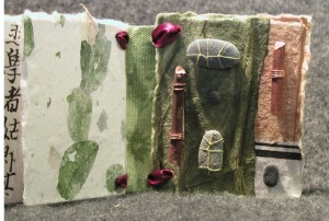 Page 5 Wee Book. Stones stitched and glued on to page. Sticks wrapped in copper wire