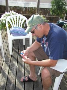 Tom examining cuts