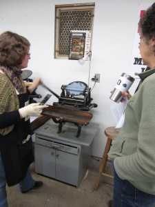 Julia inking the plate