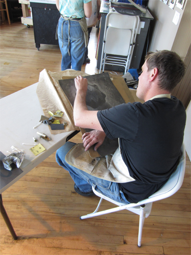 Tyler at work on his graphite drawing
