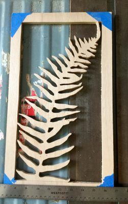 "10"" x 18"" wood cut fern."